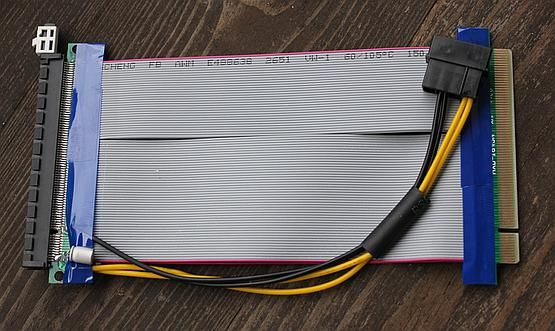 Common gray PCIe riser with required Molex 12V power connector