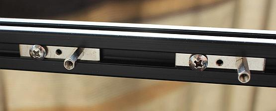 Motherboard standoffs go into the slot and can be positioned as desired