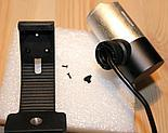 Unscrew 3 screws in the webcam holder