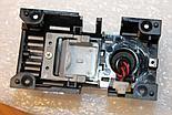Odkręć śrubę w górnej połówce i usuń przycisk oraz mikrofon